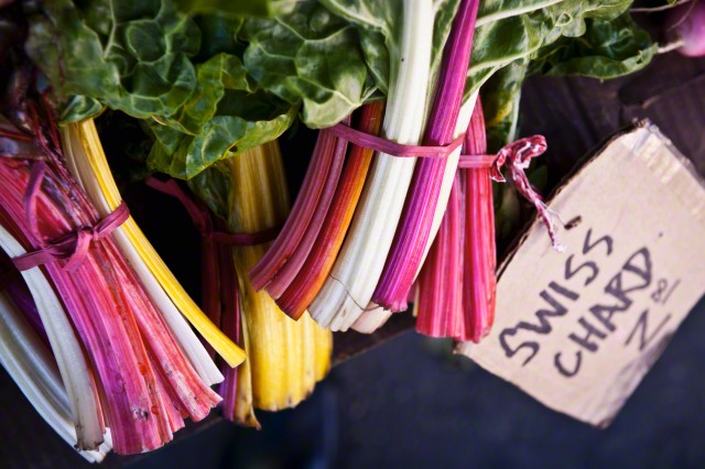 Four Bunches of Rainbow Swiss Chard Stems at a Farmer's Market with $2.00 Price Tag --- Image by © Foodcollection/the food passionates/Corbis